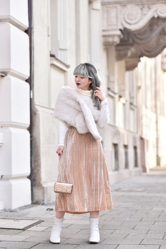 a blush pleated midi skirt, a white turtleneck, a faux fur shawl and white booties for a glam holiday look