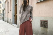10 a brown oversized sweater, rust-colored culottes and snake print shoes