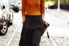 10 a burnt orange long sleeve top, a printed midi skirt, cognac booties for a chic look