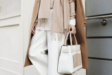 10 a chic look with a white long sleeve top, white pants, a blush sweater and scarf, a camel coat and shoes