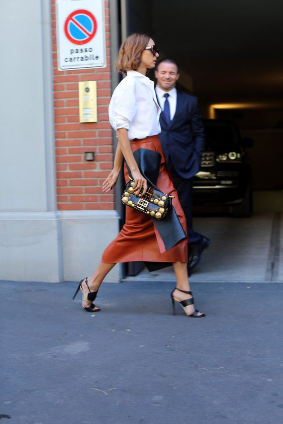 a cognac brown leather midi skirt, a white shirt and black strappy heels to wear right now