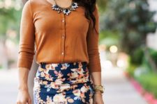 10 a floral skirt, a yellow cardigan, a statement necklace and a neutral bag