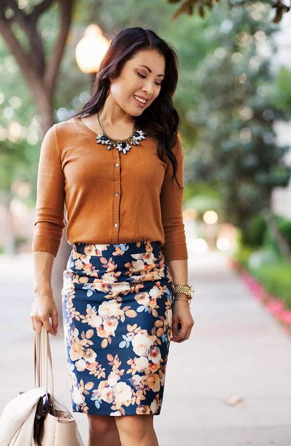 a floral skirt, a yellow cardigan, a statement necklace and a neutral bag