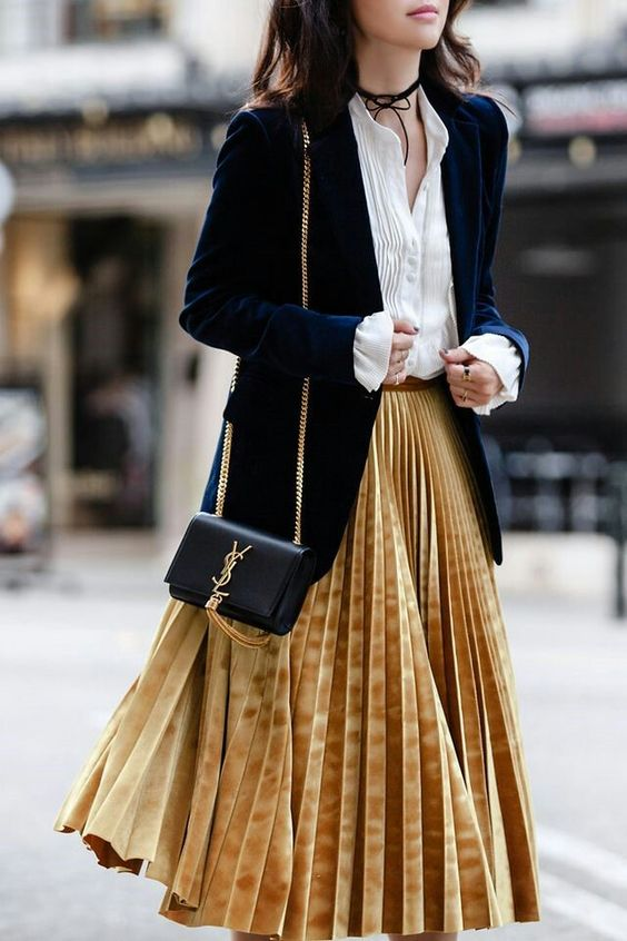 a mustard pleated velvet midi skirt, a white shirt, a navy blazer for a trendy look