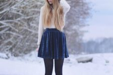 10 a white blouse, a navy velvet skirt, black tights and booties