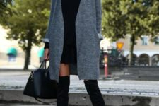 11 a black pleated mini, a black turtleneck sweater, black tall boots and a grey coat