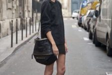 11 a black sweater, a black mini skirt, creative black and nude boots and a large bag