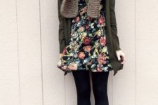 11 a floral mini dress, black tights, tall socks and brown boots, a green cardigan and a scarf