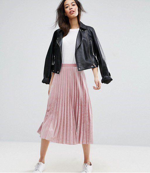 a pink pleated velvet midi skirt, a white tee, white sneakers and a black leather jacket
