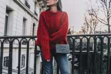 11 a red oversized sweater, blue jeans, burgundy boots and a Chanel bag