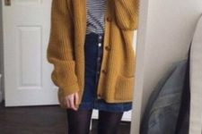 11 a vintage-inspired look with a denim skirt with a row of buttons, a striped shirt, a mustard cardigan, black tights and shoes
