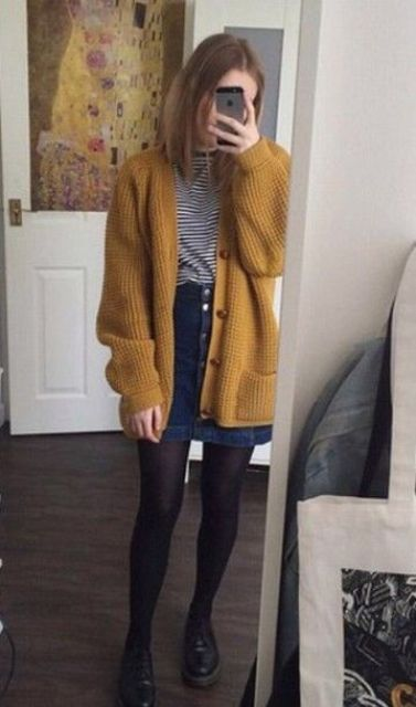 a vintage-inspired look with a denim skirt with a row of buttons, a striped shirt, a mustard cardigan, black tights and shoes