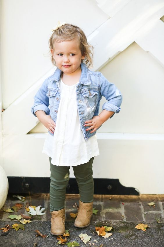 a white shirt, a cropped denim jacket, olive green pants, brown booties