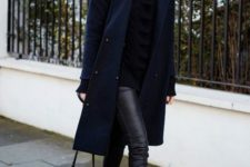 12 a black leather leggings, white sneakers, a black swetaer and a navy coat