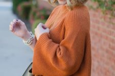 fall outfit with orange sweater