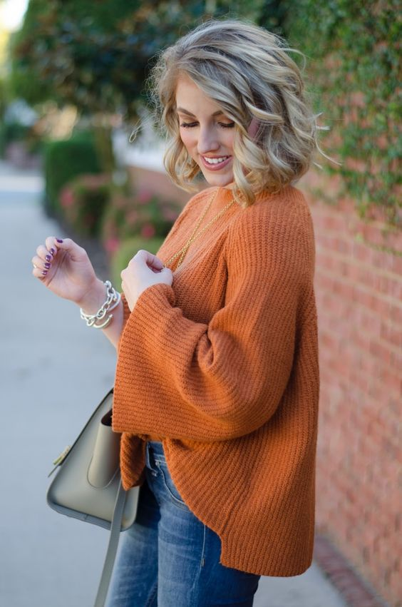 a comfy oversized burnt orange sweater with blue jeans is a great fall combo