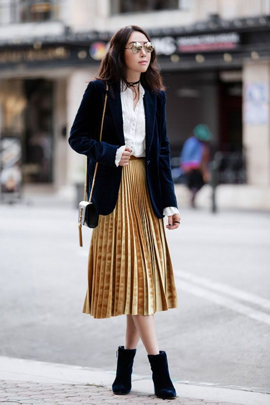 a yellow velvet midi skirt, a white shirt, a navy velvet blazer and velvet booties for a chic winter look