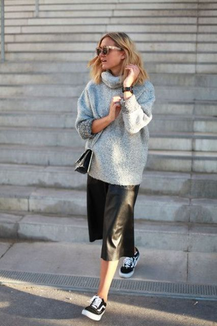 a black leather skirt, an oversized grey turtleneck sweater, black Vans and a crossbody bag