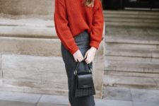 13 a grey midi skirt, an oversized burnt orange sweater, black booties and a black bag