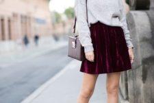 13 a grey turtleneck, a plum-colored velvet mini skirt, plum sock booties