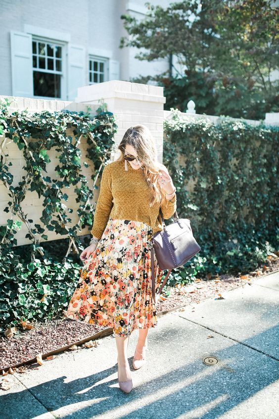 a mustard sweater, a floral pleated midi skirt, a lavender bag and shoes for a comfy look
