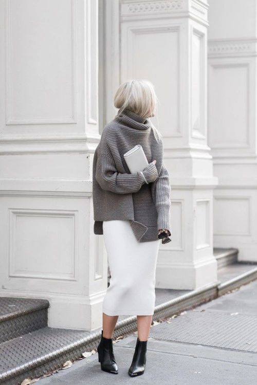 a white midi skirt, a slouchy grey turtleneck sweater, black elather sock boots