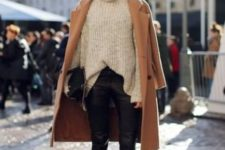 13 black cropped pants, a neutral turtleneck sweater, black booties and a camel coat