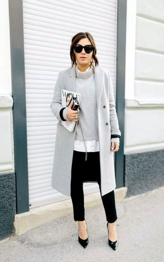 black jeans, a white shirt, a grey turtleneck sweater, black heels and a grey coat