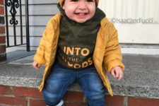 13 jeans, a khaki hoodie, a yellow jacket and beanie and beige booties