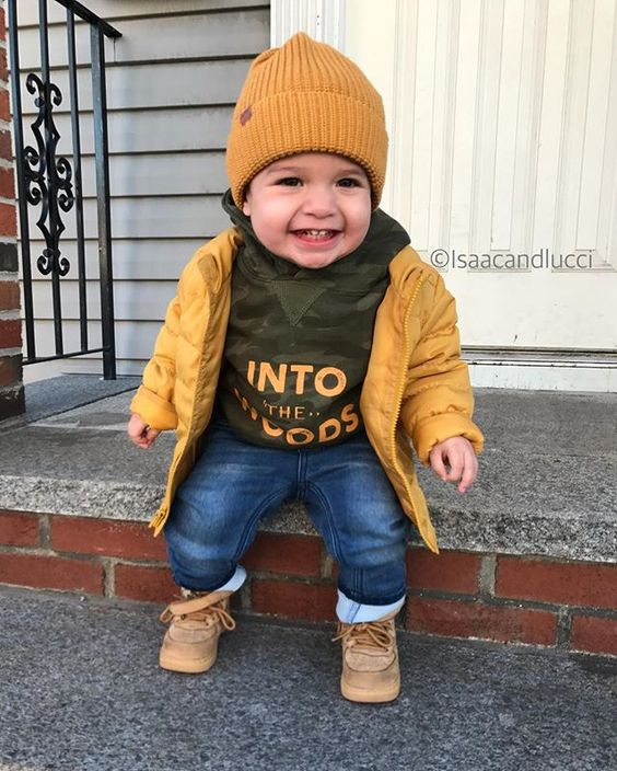 jeans, a khaki hoodie, a yellow jacket and beanie and beige booties