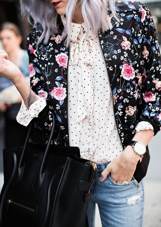 a black floral bomber with pink roses over a polka dot shirt looks very feminine