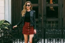 14 a black tee, a red denim skirt, a black leather jacket, black boots