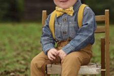 14 amber jeans and booties, a chambray shirt, mustard suspenders and a bow tie for a vintage look