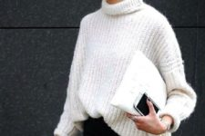 14 black jeans and a white oversized sweater is a perfect combo to try