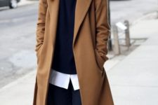 14 black pants, a black sweater over a white shirt, black suede shoes and a camel coat