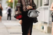 15 a bold bohemian look with a printed blouse with bell sleeves, a black velvet skirt with a slit, velvet shoes and a silver bag