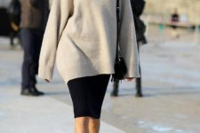 15 black leather booties, a black pencil skirt and a neutral oversized sweater