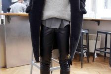 15 black leather leggings, black chelsea boots, a grey tee, s grey sweater and a navy coat