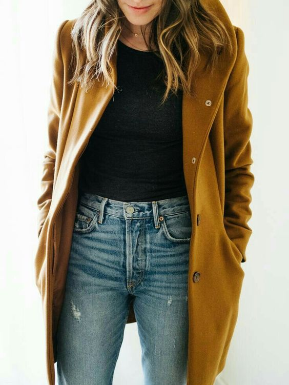 blue jeans, a black tee and a mustard coat on top to look casual and fall-like