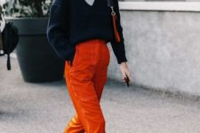 15 burnt orange velvet pants, a slouchy navy sweater over a white top and nude flats