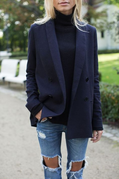 ripped jeans, a black turtleneck and a navy blazer of wool for a casual look