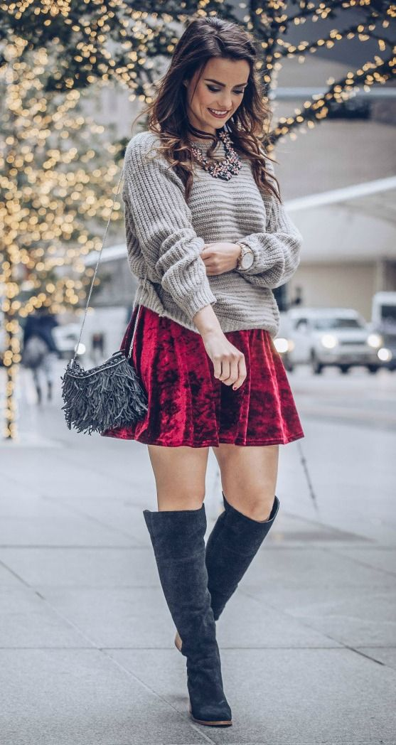 c535f65d9f8 pair a red velvet mini skirt with an oversized neutral sweater and suede  boots