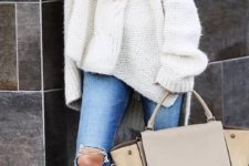 16 ripped jeans, a white slouchy sweater, a neutral scarf, brown booties
