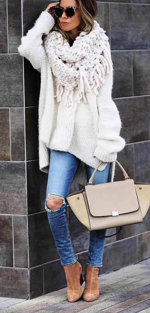ripped jeans, a white slouchy sweater, a neutral scarf, brown booties