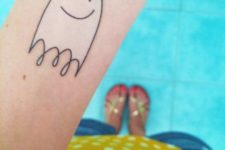 Adorable little ghost tattoo on the forearm