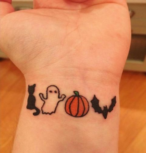 Picture Of Cute Tiny Ghost Cat Pumpkin And Bat Tattoos On The Wrist