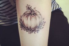 Excellent pumpkin tattoo on the arm