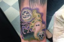 Halloween tattoo with ghost at the craveyard