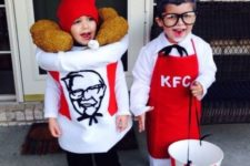 One boy as Sanders and other boy as bucket of fried chicken