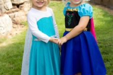One girl as Elsa and other one as Anna from Frozen movie